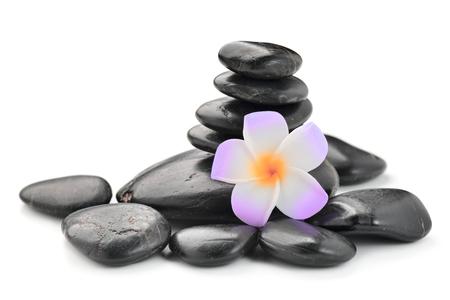 zen basalt stones and Frangipani  isolated on white Stock Photo