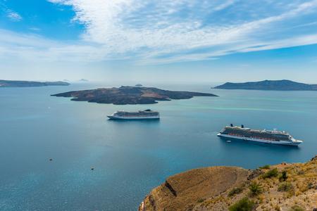 Luxury cruiser in Fira Bay Stock Photo
