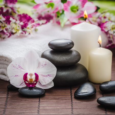 spa still life with zen basalt stones ,orchid and bamboo with candle Stock fotó