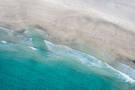 Aerial vertical View Splashing Sea Waves on the Beach