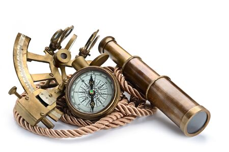 vintage still life with compass,sextant and spyglass isolated on white background Stockfoto
