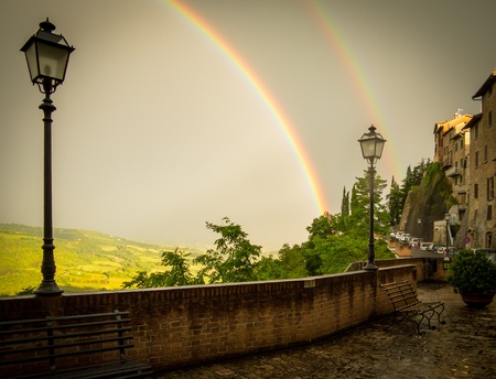 lampost: Double Rainbow with Lampost and Wet Streets in Italy Stock Photo