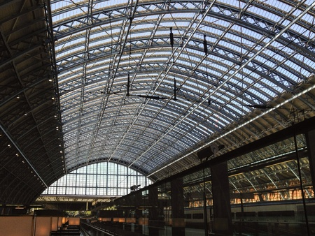 girders: Glazed roof from inside with intricate beams and girders and glazing. Leading to the arch of the structure above the train platforms