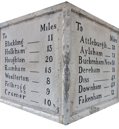 Crop of stone mileage marker and distance of Norfolk Towns