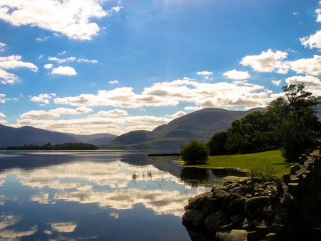 eire: Reflections of the sky in mountains in a Lake near Killarney, Eire Stock Photo