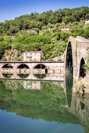 mediaval: Ponte della Maddalena mediaval bridge across the Serchio. Tuscany. Bridge of the Devil
