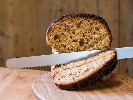 Slicing Granary Bread on a Wooden Board