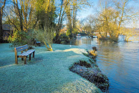 Frosty bench and lawn on the banks of the River Thames