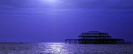 Brighton old pier at dusk