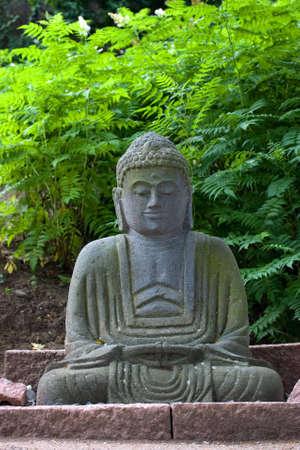 Buda statue in a Japanese garden Stock Photo