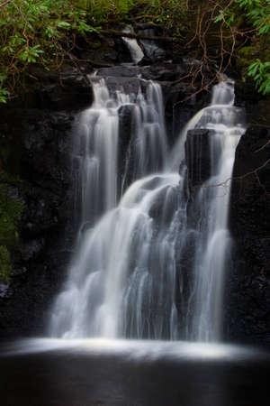 Waterfall near Dunvagan castle on the Isle of Skye Stock Photo