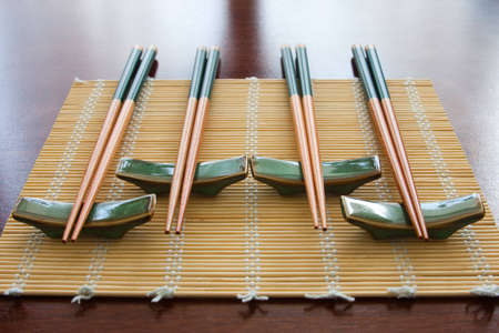 Chopsticks on table mat