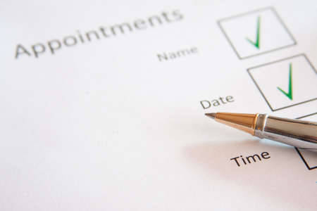 Appointment sheet with pen Stock Photo