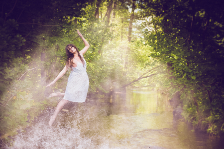 water nymph: Water nymph - woman levitating over water Stock Photo