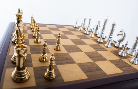 Chess set with gold and silver pieces 版權商用圖片