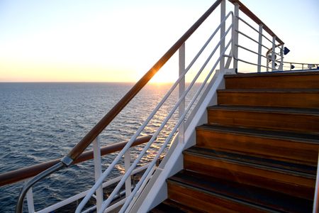 Railing and stairs of a cruise ship at sunset. 版權商用圖片