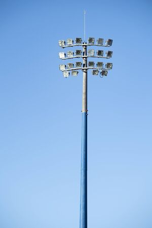 Sports stadium light tower during the day, set against a blue sky. Imagens
