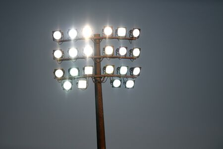 Sports stadium light tower during the night, set against a dark sky.