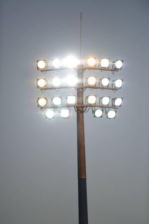 Sports stadium light tower during the night, set against a dark sky.
