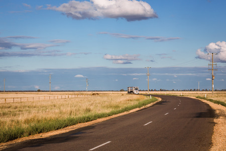 A truck approaches a bend on a country road in regional New South Wales.