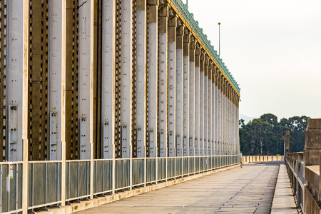 Steel and concrete sluice gates, viewed along the crest of the Hume Dam. Albury, New South Wales.