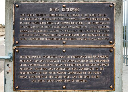Commemorative plaque on the Hume Dam, unveiled during the opening ceremony in 1936. Albury, New South Wales.