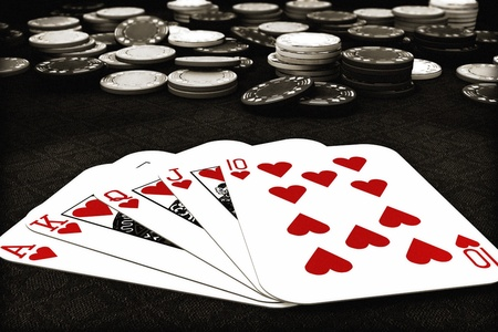 Poker suit Royal Flush of hearts with depth of field poker chips in background , 300 D.P.I
