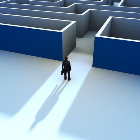ontbering: Een zakenman bij de ingang van een doolhof Stockfoto