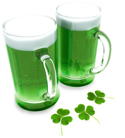 irish culture: Two green beers with clovers for St Patricks day isolated on a white background  Stock Photo