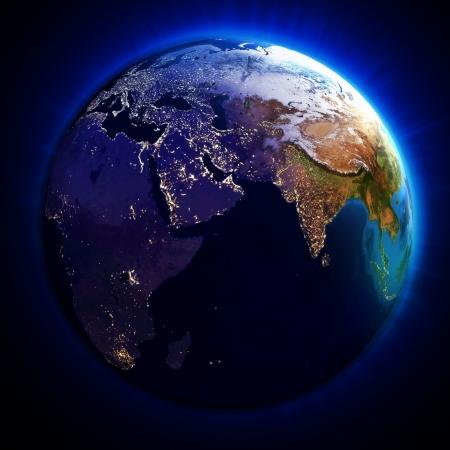 iluminados: La Tierra con el día y la vista de noche, elementos de esta imagen proporcionada por la NASA Foto de archivo