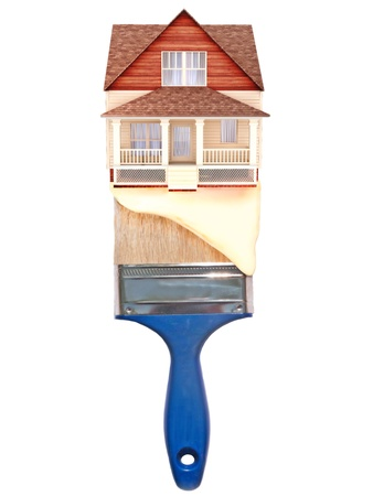home deco: House painting concept  House on top of a blue paintbrush with paint dripping down
