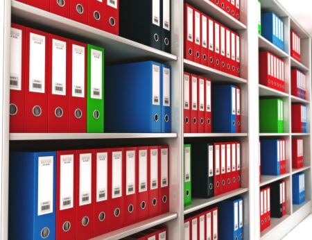 bureaucracy: Office ring binders on a bookshelf with depth of field