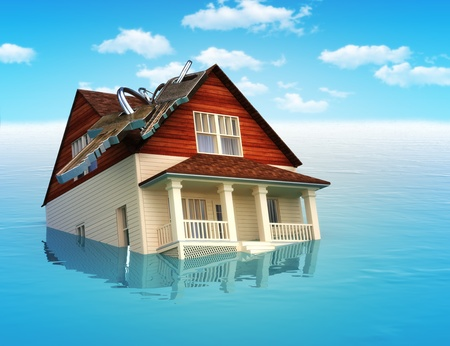 damages: House sinking in water ,real estate housing crisis,flooding, ect  concept  Stock Photo