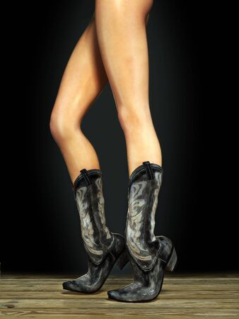 Long sexy legs wearing cowboy boots photo