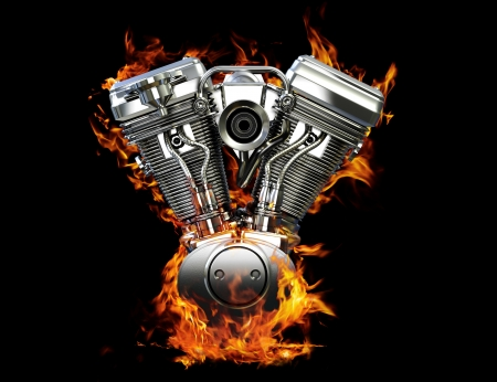 Chromed motorcycle engine on fire on a black background Stock Photo