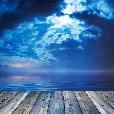 boardwalk: DEck view over lake or calm ocean, scenic twilight background Stock Photo