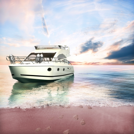 tour boats: Yacht anchored on the beach with couple s foot prints in the sand Stock Photo