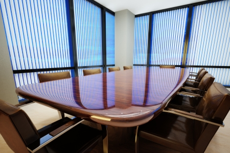 company board: Business office conference room with table and leather chairs