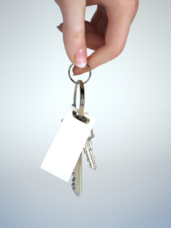Hand holding keys with key chain having room for text ,graphic or copy space  Vehicle ownership , insurance,service ect  Gradient background Stock Photo - 17724036