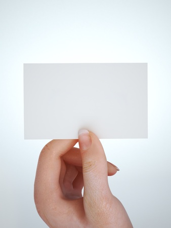 business card in hand: Hand holding business card with room for text or copy space, gradient background