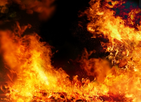 Burning fire background on black