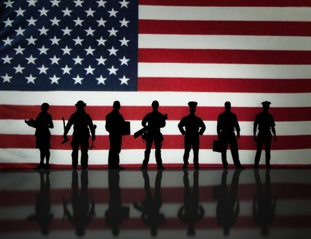 office force: American workers silhouette with an American flag background