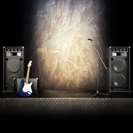 Heavy metal music stage or singing background, microphone, electric guitar and speakers with diamond plated flooring photo