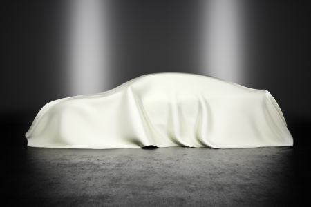 Covered car with studio lighting, innovation technology or hidden secret concept