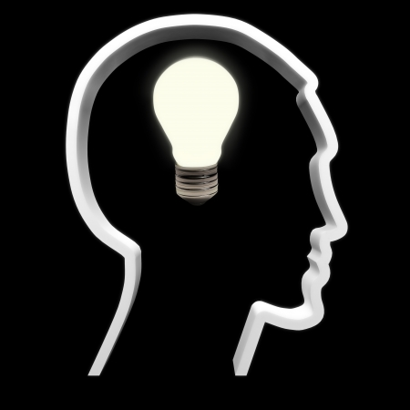 ingenuity: A light bulb symbolizing intellectual , innovation and inspiration is turned on in a human head  Stock Photo