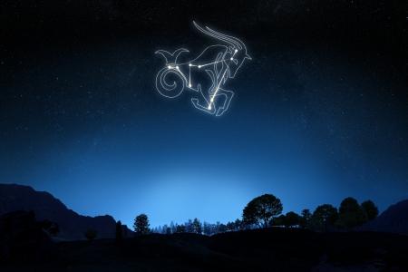 グラデーション空の背景の星とシンボル アウトライン星座山羊座 写真素材