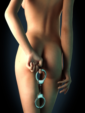 Young woman nude, holding hand cuffs behind her back  Stock Photo