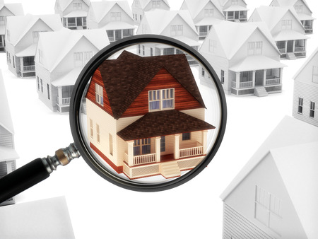 real estate background: Real estate watch  House with a magnifying glass   Stock Photo