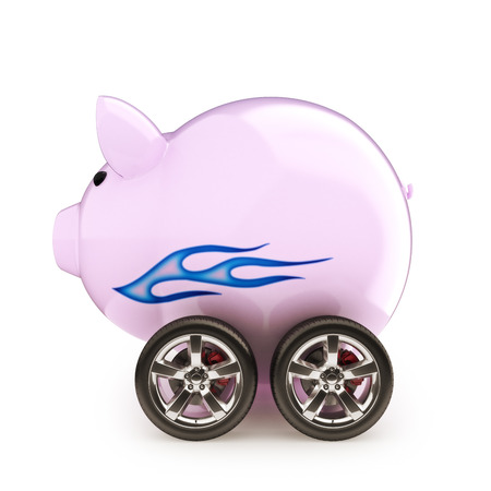 Sports car savings  Piggy bank with wheels on a white  photo