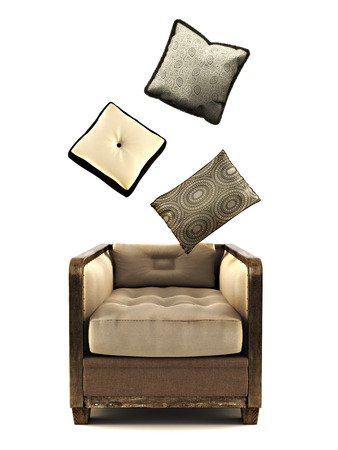 Armchair with pillow s on a white Stock Photo - 24062081